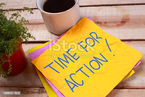 Time For Action words letter, written on piece of memo paper, work desk top view. Motivational business typography quotes concept
