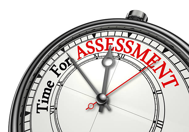 Time for assessment concept clock stock photo