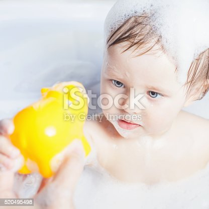 520441939 istock photo Time for baby's bath 520495498