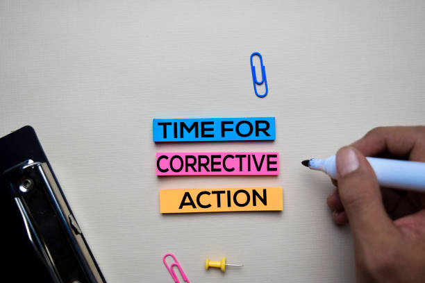 Time for Corrective Action text on sticky notes with office desk concept stock photo