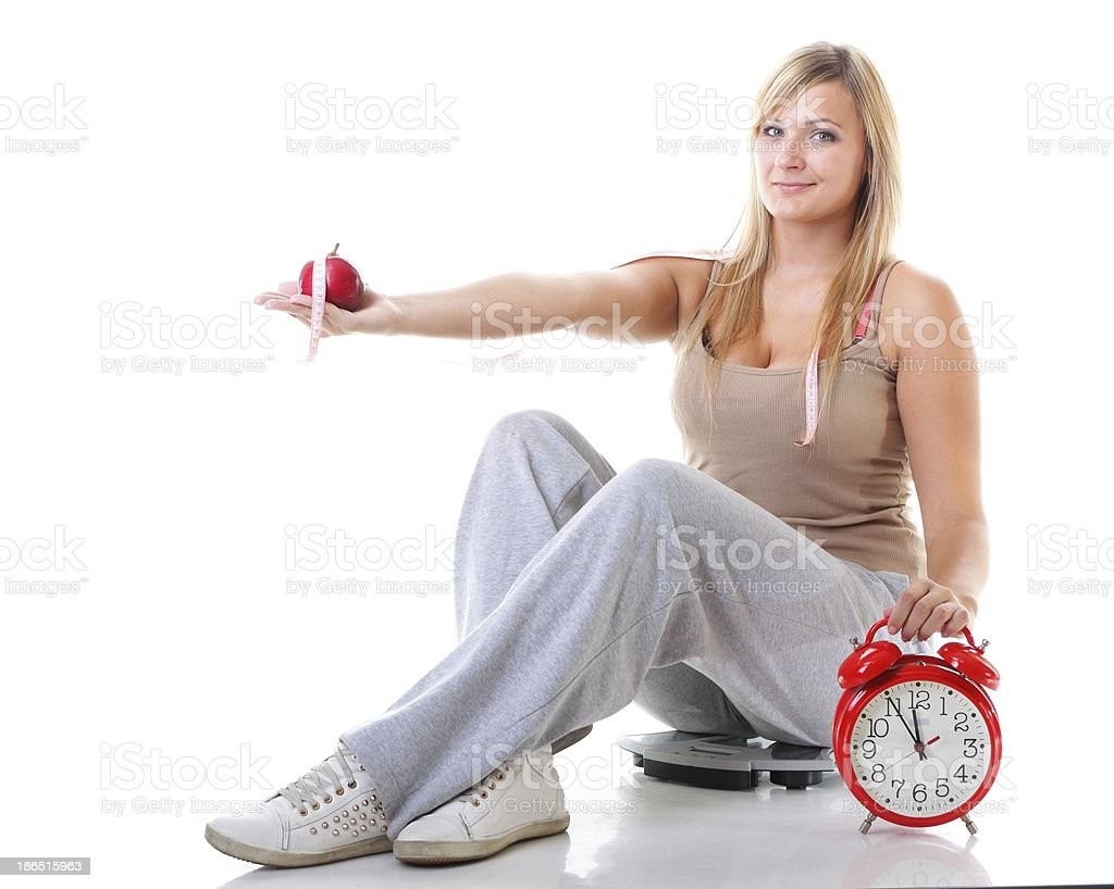 Time for diet slimming. Large girl with scale. royalty-free stock photo