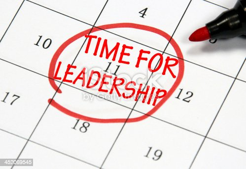time for leadership sign written with pen on paper