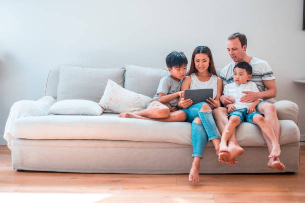 Best Asian Family Living Room Sofa Stock Photos, Pictures ...