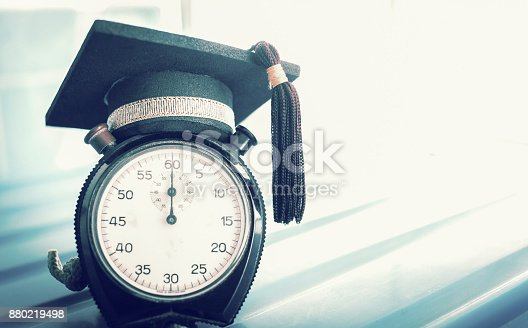 959387240 istock photo Time is  Education, Graduation cap on top clockConcept of educational times Studies lead to success in life, Graduate study abroad program. 880219498