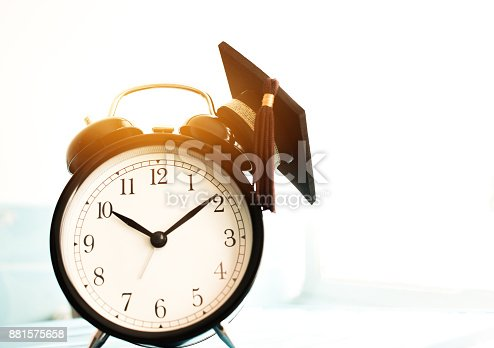 959387240 istock photo Time is  Education, Graduation cap on top clockConcept of educational times Studies lead to success in life, Graduate study abroad program. 881575658