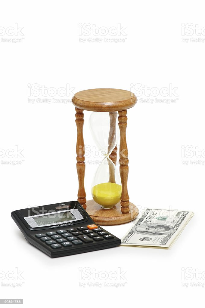 Time is money - calculator, hourglass and dollars royalty-free stock photo