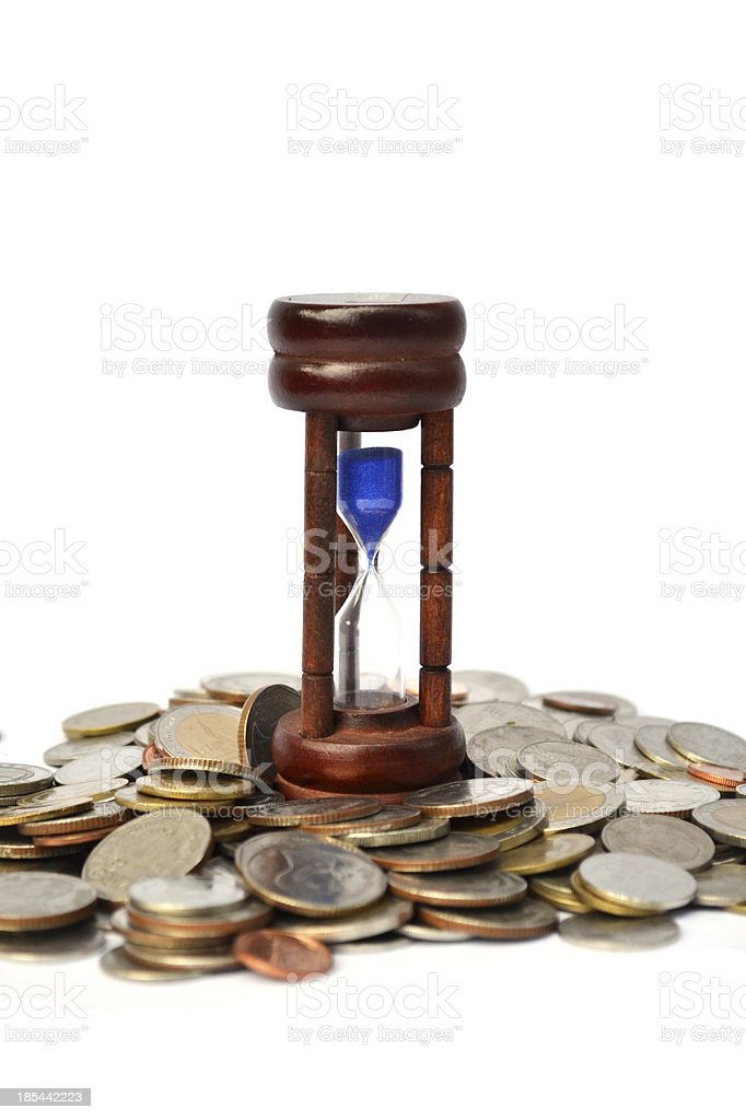 Time is money coins with sandwatch stock photo