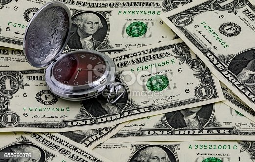 Time is money concept, traditional pocket watch and one US dollar banknotes