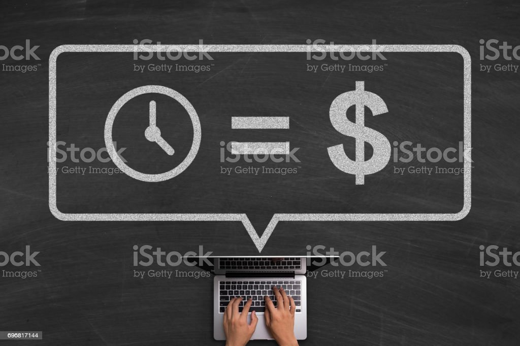 Time Is Money Concept With Laptop On Blackboard stock photo