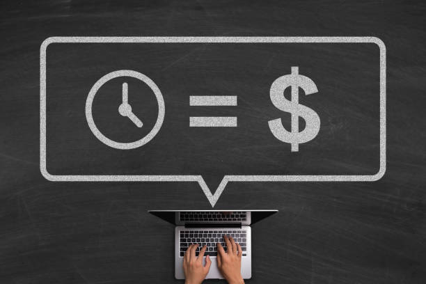 Time Is Money Concept With Laptop On Blackboard Time Is Money concept with hands typing laptop on the blackboard background. time is money stock pictures, royalty-free photos & images