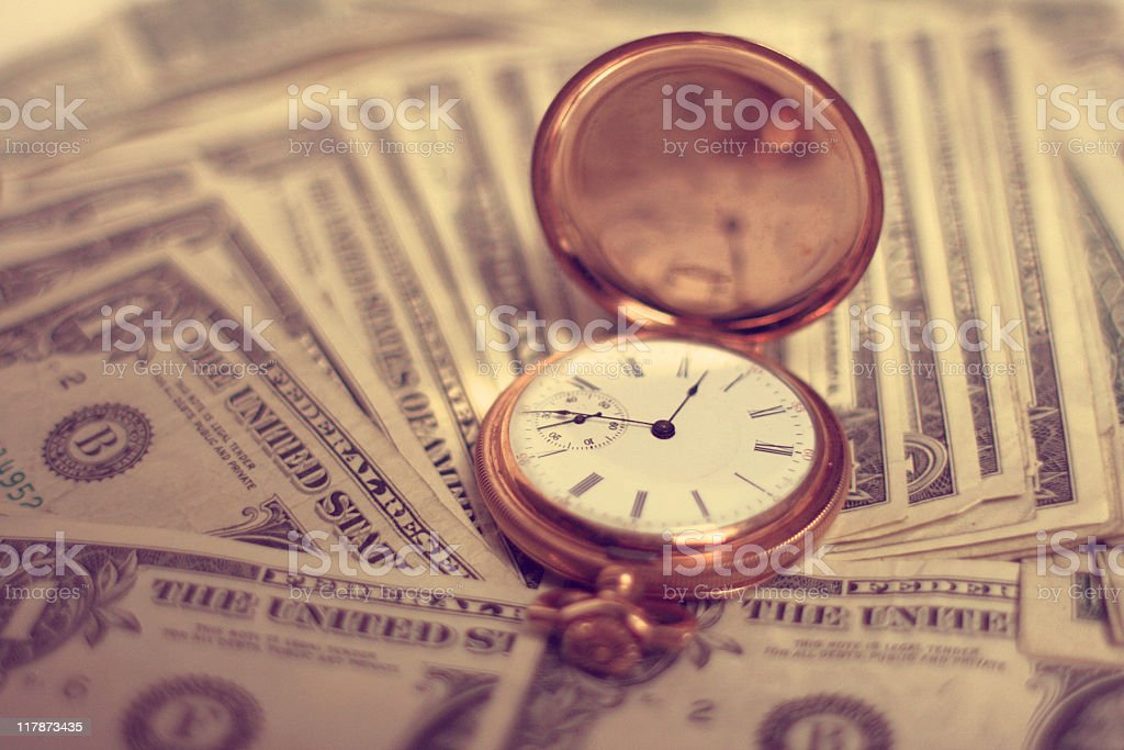 Time is Money - Gold Pocketwatch on Dollar Bills royalty-free stock photo