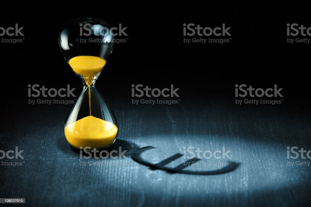 Time is Money, Hourglass with Euro Sign Shadow royalty-free stock photo