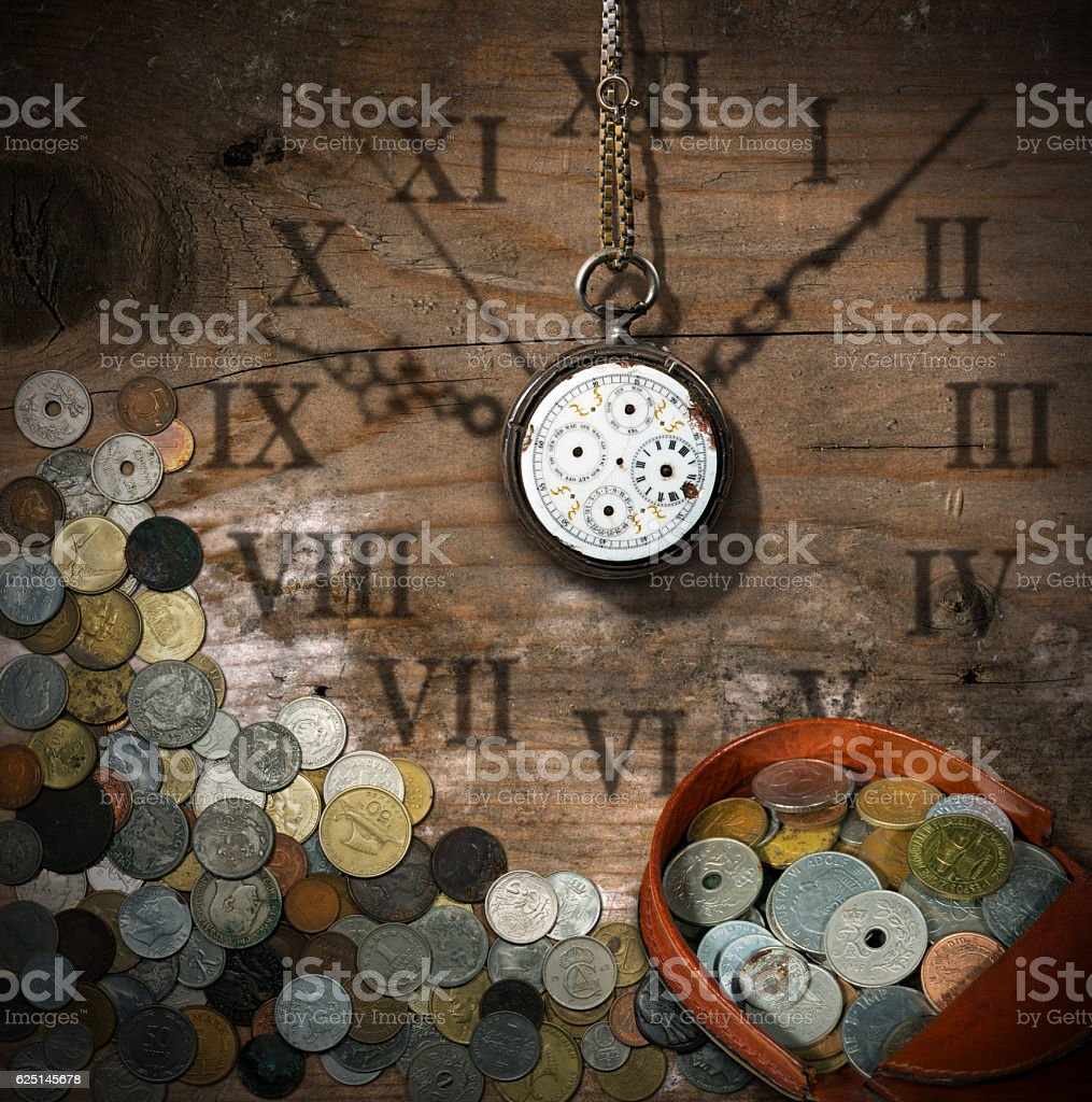 Time is Money - Old Watch and Coins stock photo
