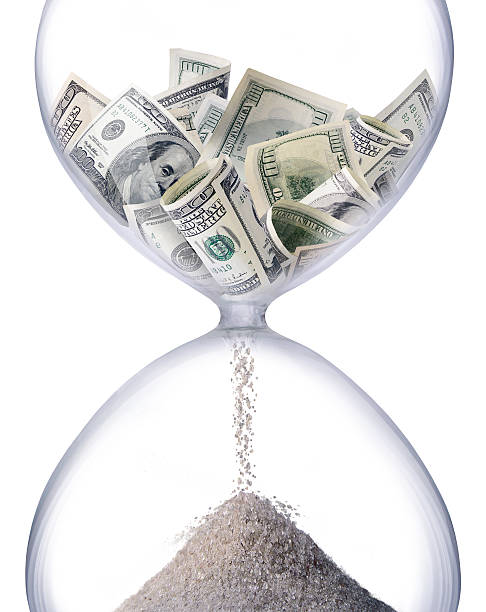 time is money Sand-glass symbolizing business time. time is money stock pictures, royalty-free photos & images