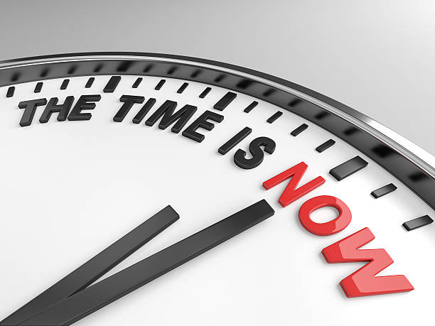 Time is Now Clock with words The Time is Now on its face ASAP stock pictures, royalty-free photos & images