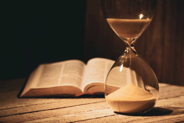 Time is running out hourglass concept stock photo