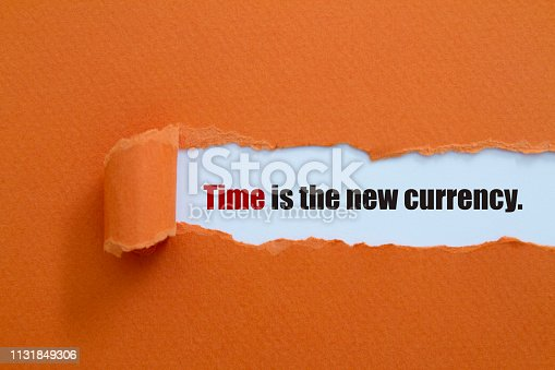 Time is the new currency written under torn paper.