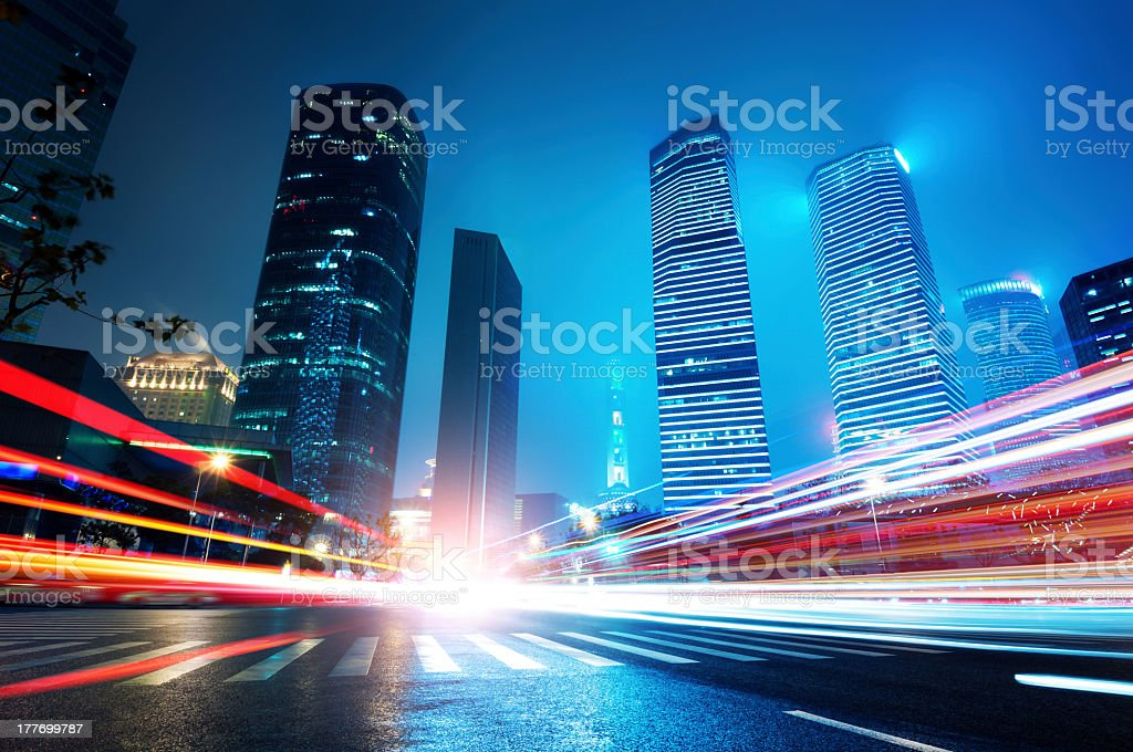 Time lapse image of lights and cars in a city at night stock photo