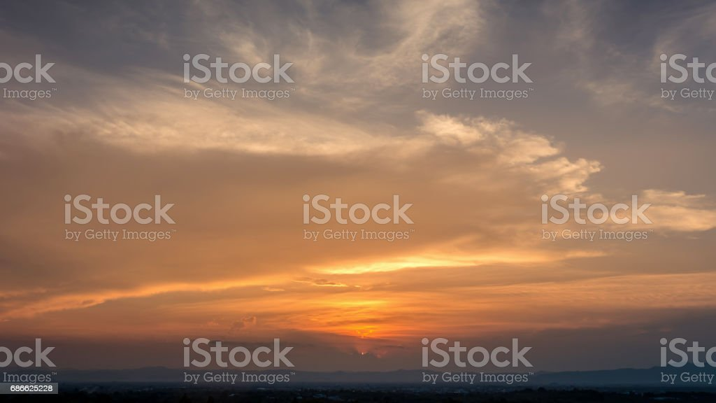 Time Lapse of Colorful dramatic sky with cloud at Sunrise.Sky with sun background. royalty-free stock photo