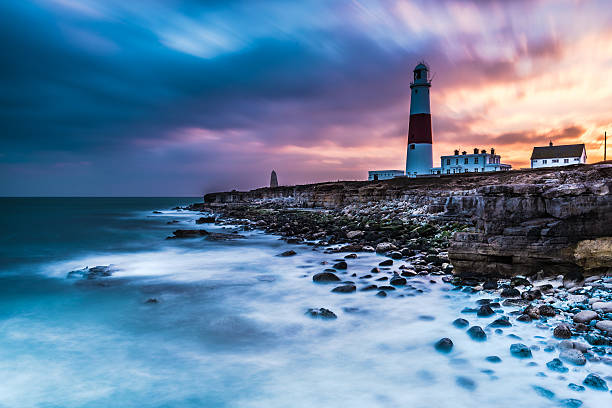 Time lapse of dramatic sunset and Portland Bill lighthouse stock photo