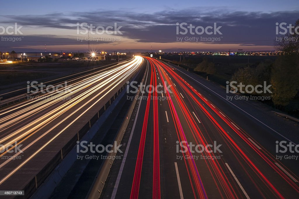 A time lapse photograph of highway headlights and taillights stock photo