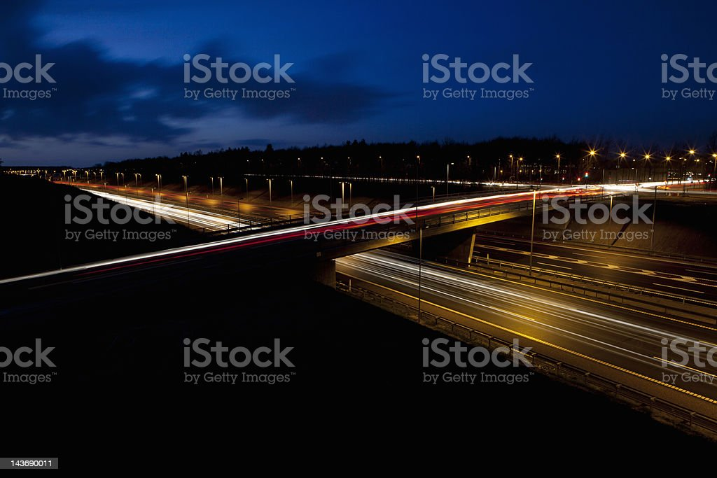 Time lapse view of traffic at night stock photo