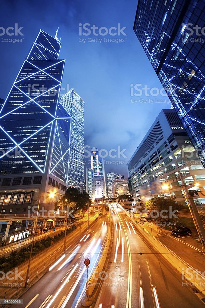Time lapsed photo of city buildings and road at night royalty-free stock photo