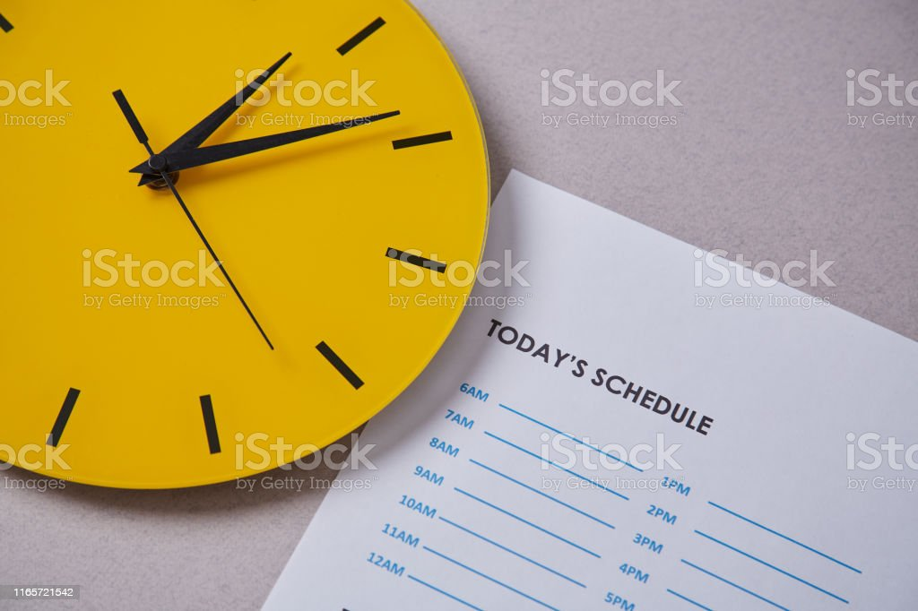 Time management deadline and schedule concept: yellow clock on the...