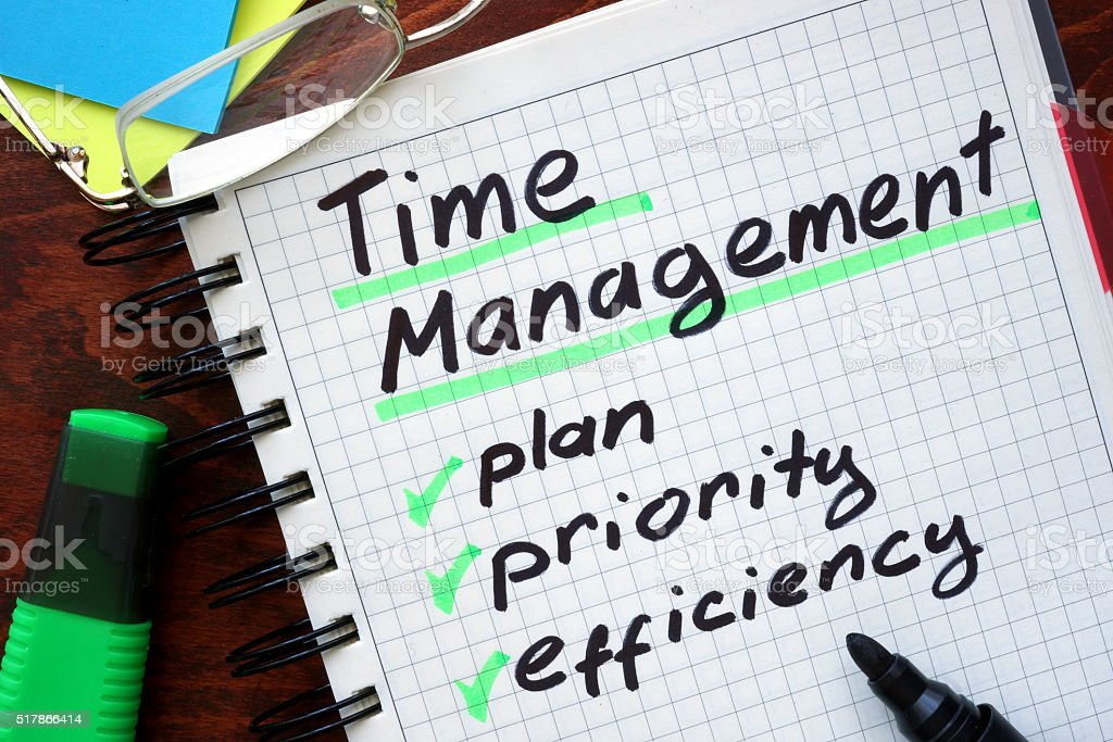 Time Management written on a tablet. stock photo