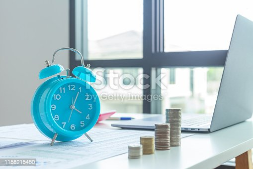 istock Time of saveing value money : business ideas and competition and strategy plan with clock background, Idea of value to finance and saving money. 1158215450