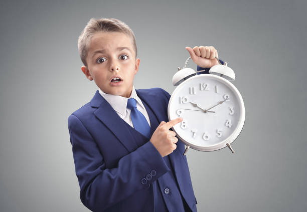 Time on clock shocked and surprised late young executive businessman boy stock photo