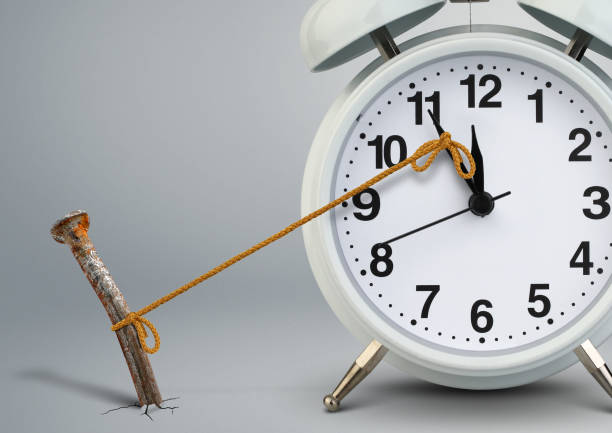 Time on clock stop by nail, delay concept Time on clock stop by nail, delay concept clock hand stock pictures, royalty-free photos & images