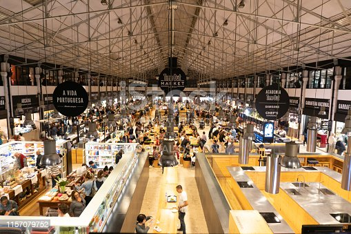 LISBON, PORTUGAL - November 1, 2017: Time Out Market is a food hall located in Mercado da Ribeira at Cais do Sodre in Lisbon. A popular foodie attraction visited by people from all over the world.