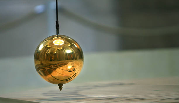 time - pendulum stock photos and pictures