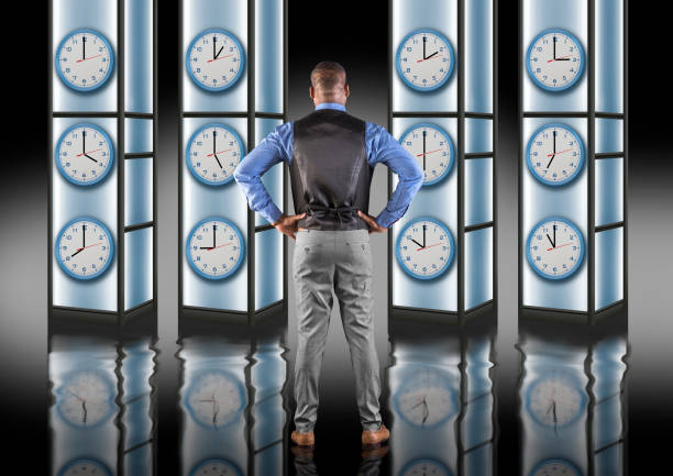 Time pressure deadline concept with man looking at clock stock photo