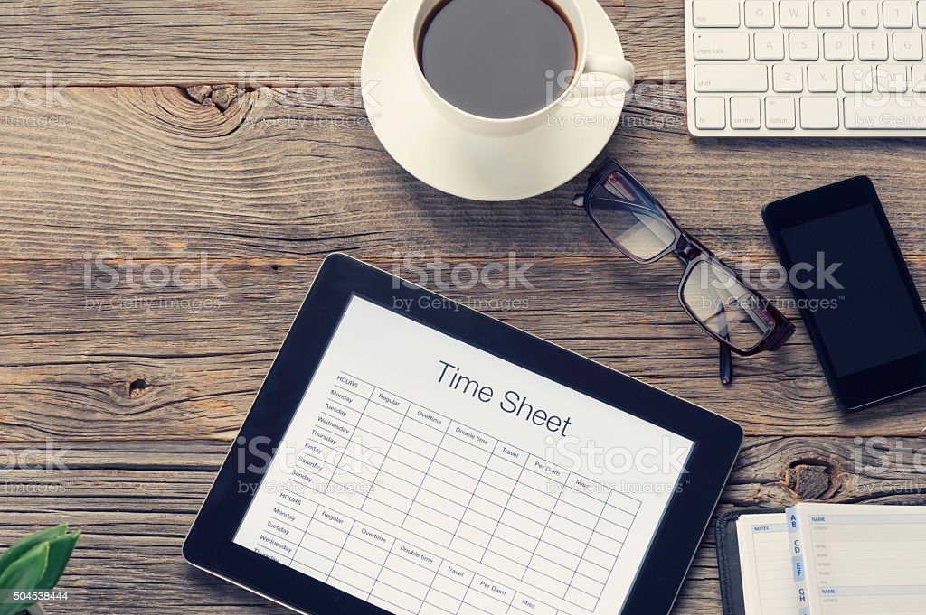 Time sheet on a digital tablet. stock photo