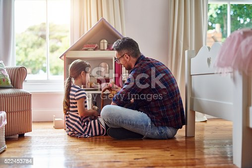 Shot of a father playing with his daughter
