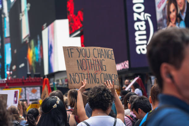 Time Square, New York City. Nonviolent Protesters. Young People Gathered for a Protest Against Global Warming. stock photo