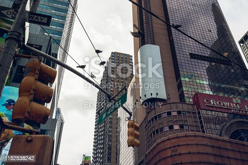istock Time Square, New York City. Skyscrapers and Traffic Light. The intersection of Broadway and 48th Street. 1152538242