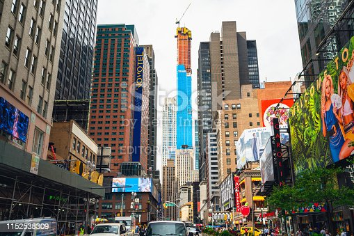 981808424 istock photo Time Square, New York City. Skyscrapers, Billboards, Neon Art and Traffic 1152538309