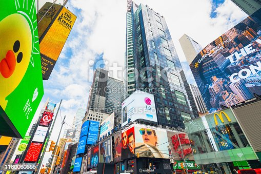 981808424 istock photo Time Square, New York City. Skyscrapers, Billboards, Neon Art and Traffic 1160060555