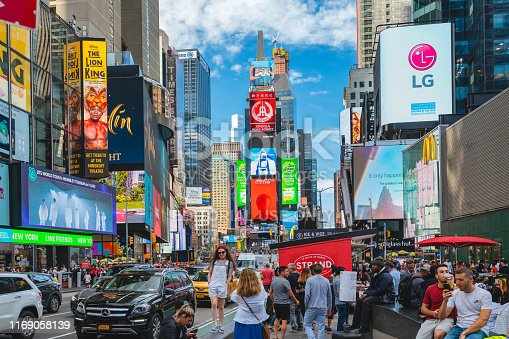 981808424 istock photo Time Square, New York City. Skyscrapers, Billboards, Neon Art and Traffic, People 1169058139
