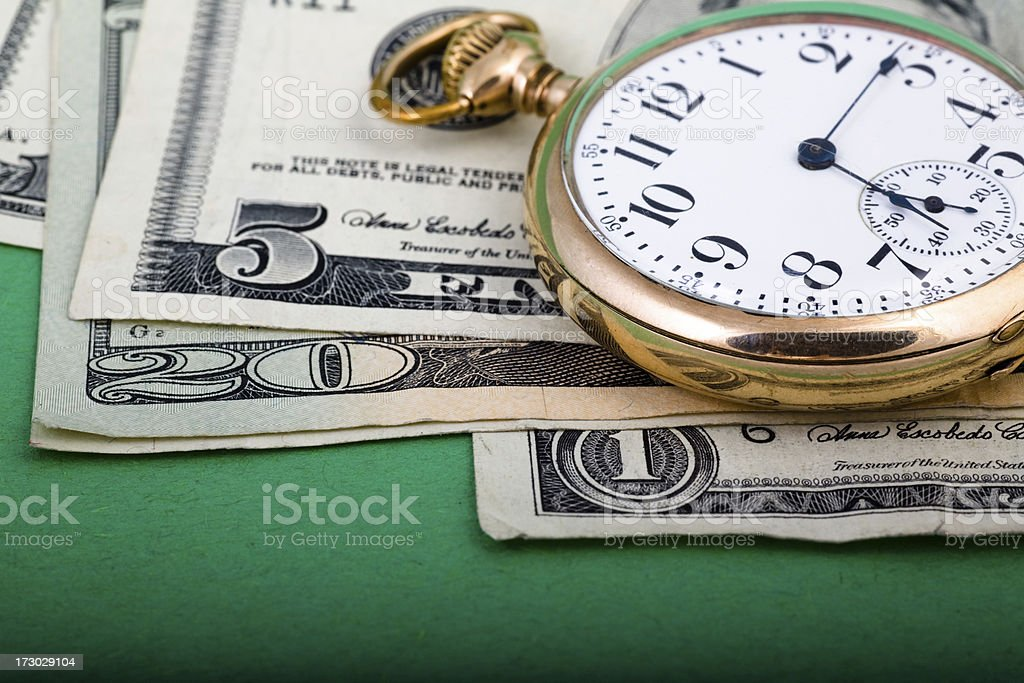 Time ticking over dollar royalty-free stock photo