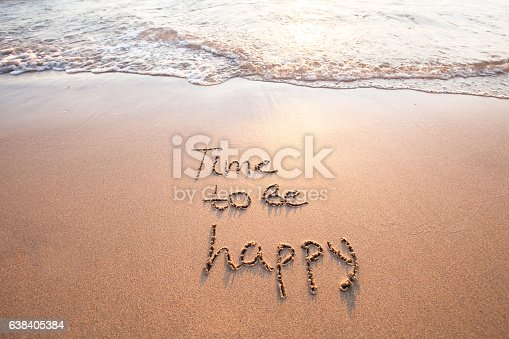 time to be happy, happiness concept, text on sand