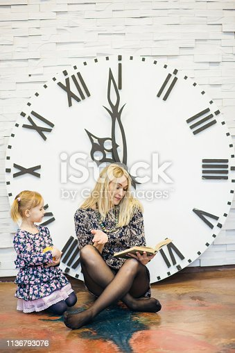 Mother and daughter having time together. Time for two. Concept of psychology, friendship, having good time together. Teaching a child. Playing togather.