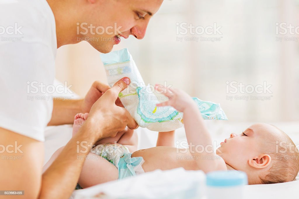 Time to change the diapers! stock photo