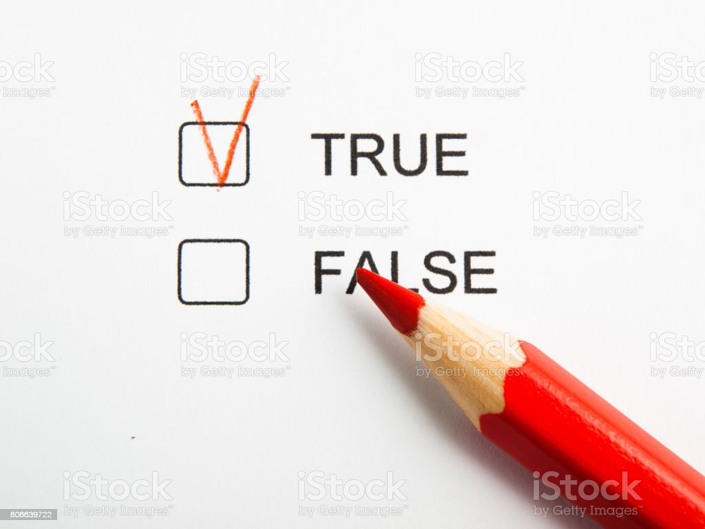 Time to choose true not false with red pencil stock photo