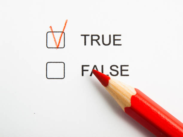 time to choose true not false with red pencil - imitation stock photos and pictures