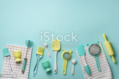 istock Time to cook. Pastel yellow, blue cooking utensils on turquoise background. Food ingredients. Cooking cakes and baking bread concept. Copy space. Top view. Flat lay 1003098066