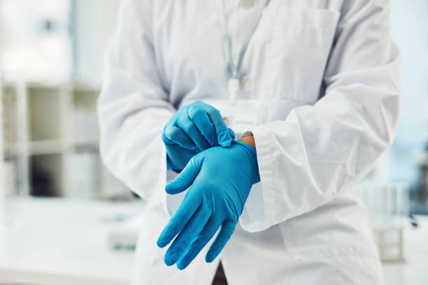 Time to dig in to another investigation Closeup shot of scientist putting on protective gloves in a lab surgical glove stock pictures, royalty-free photos & images